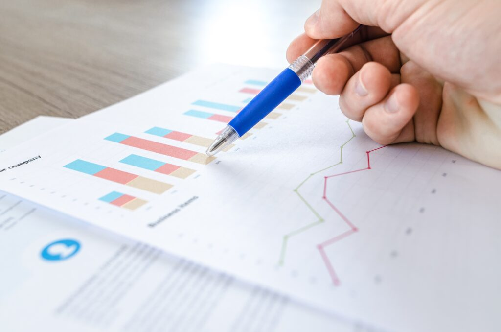 Person looking at chart data at desk