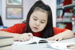 Young student reading at school