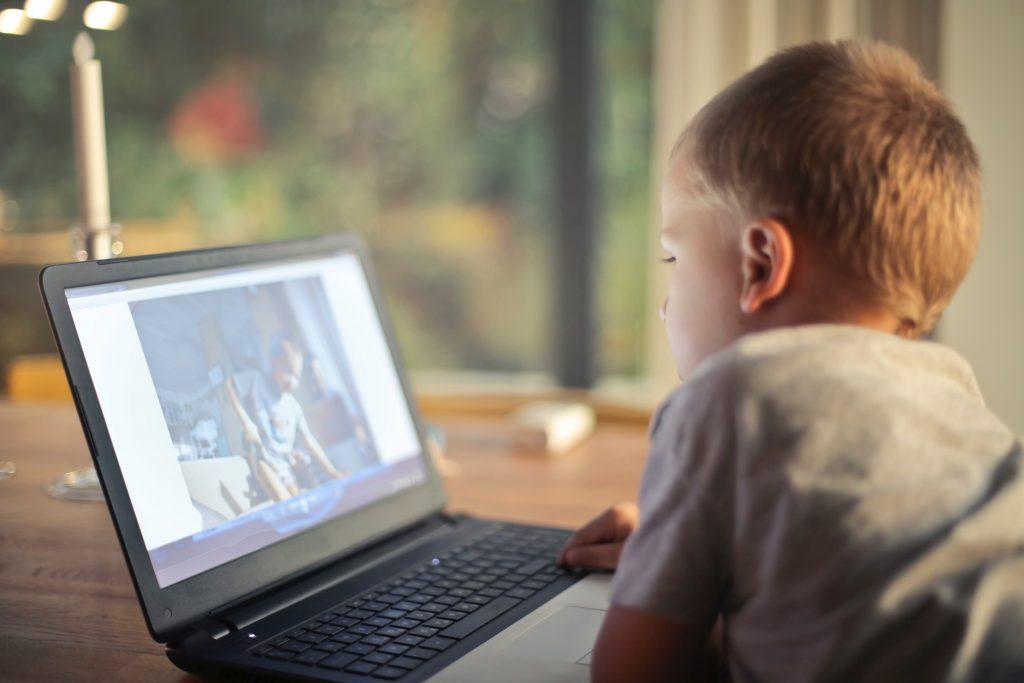 Boy watching video on laptop