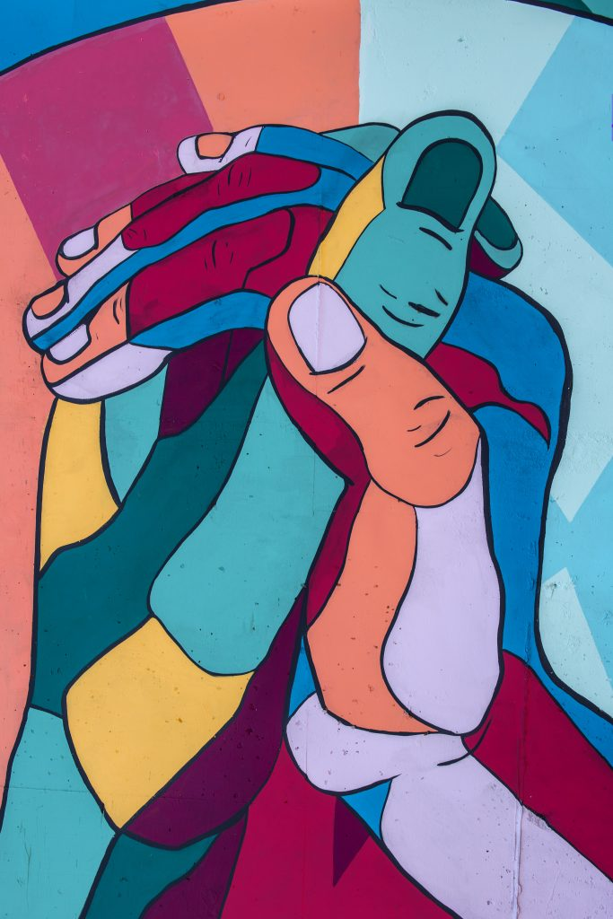 mural of colorful hands clasped together