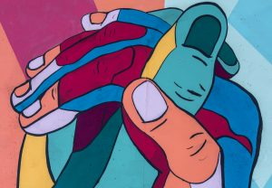 mural colorful hands clasped together