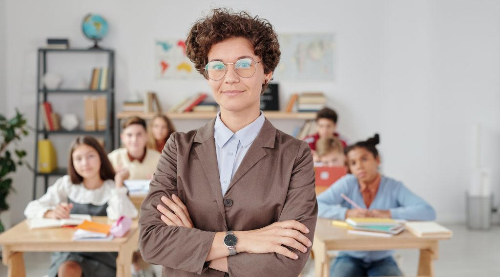 Teacher standing in front of students