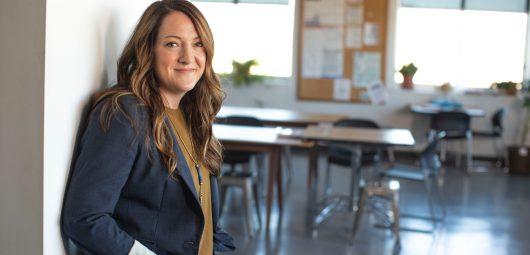 Woman standing in doorway of classroom