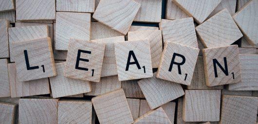 "The word ""LEARN"" in scrabble tiles"